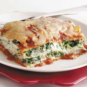 My Mom's Spinach Lasagna Recipe: Filling works for calzones too! Super EASY! Bottle of Ragu, 16 oz sour cream, 15 oz ricotta cheese, defrosted shredded spinach block. Mix and layer with lasagna noodles and cheddar cheese. Bake @ 350 degreesfor 40 min or until the cheese bubbles.