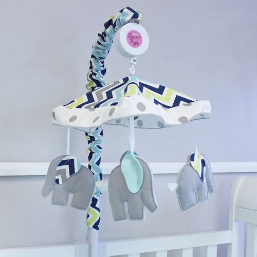 Musical Mobile with cute grey elephants will keep baby mesmerized.  Elephants have 3D ears in matching Chevron Navy fabrics.