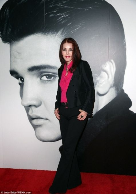 {*Priscilla Presley by Elvis's Photo , 2014 she & Lisa must miss him so much they stayed Very Close friends even though they were discovered right up until his death :( that's why she still lives in there other house they shared she has said all the Memories are still here :(