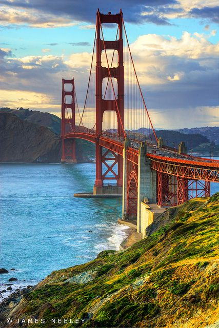 The Golden Gate Bridge glows in the evening light at sunset in the Bay Area, San Francisco