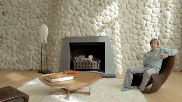 NOWNESS's latest In Residence video features design icon Marc Newson in his London home. Most interested in scale, the designer talks about his ultra-modern-meets-rustic space that includes a huge river rock wall, mock-Victorian details like a wood-paneled library, and other details clearly designated by Newson's wife, fashion stylist Charlotte Stockdale.