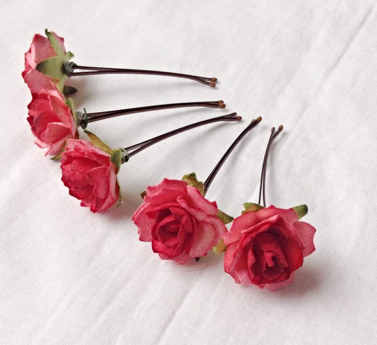Delicate red roses with hints of green leaves adorn metal hair pins. These hair pins are perfect for weddings including bridesmaids and flower girls, birthdays or and other special occasion. Each pin