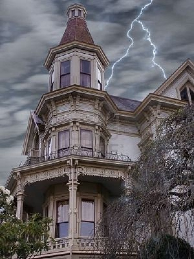 Stern looking victorian mansion weathers a lightening storm
