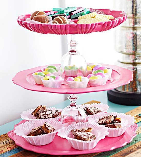 Tiers and Tiers Round up a few plates and a few goblets, and you have the makings for a tiered serving tray. Use glass adhesive to secure the bottom of a goblet to the underside of a dish and repeat with a second dish and goblet. When dry, stack the pieces on a third plate.