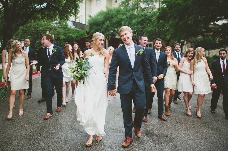 Great natural pose that also includes the large bridal party without looking too heavy