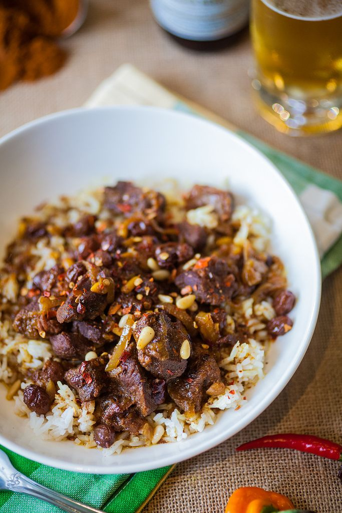 Tender lamb slow cooked in a crock-pot with Moroccan spices, raisins, and pine nuts.