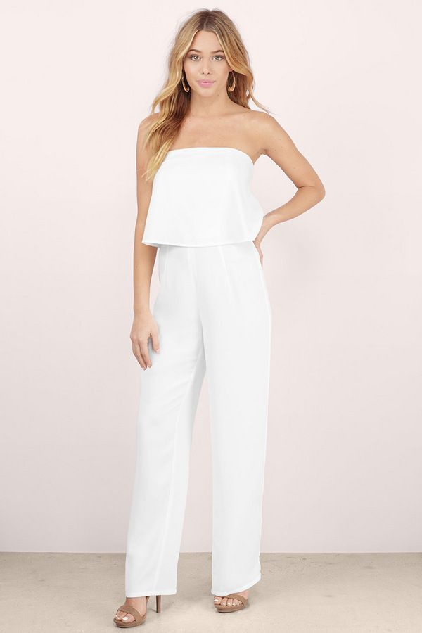 Break hearts in the Heart Breaker Strapless Jumpsuit. Strapless jumpsuit with a two-fer overlay at the bodice and wide legs. Wear with classic heels and bold jewelry to compliment. Get 50% off your order when you join Tobi.com