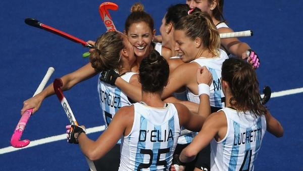 : Luciana Aymar of Argentina celebrates scoring her team's fourth goal with her team mates during the Women's Pool WB Match W04 between Argentina and South Africa at the Hockey Centre on July 29, 2012 in London, England.