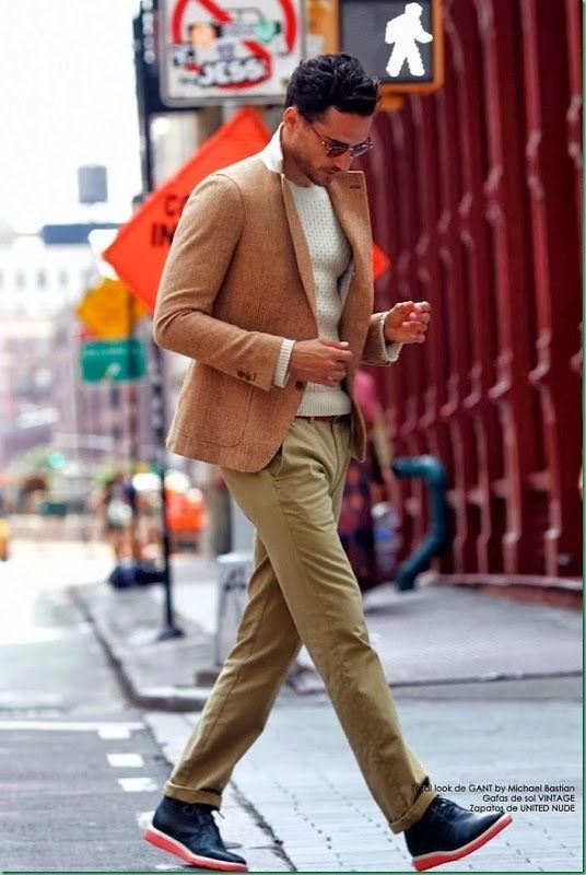 Shop this look on Lookastic: https://lookastic.com/men/looks/tan-blazer-white-crew-neck-sweater-khaki-chinos-navy-desert-boots/1080 — Tan Blazer — Khaki Chinos — White Crew-neck Sweater — Navy Leather Desert Boots