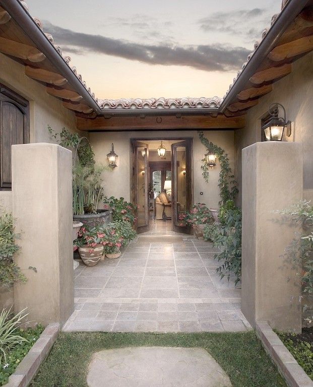 Small spanish courtyard entry.    This could be an alternative to a full interior courtyard.  Could put the fabulous iron gate on it as well, but just not inside the house.