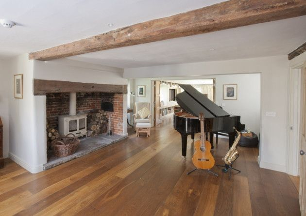 The Music Room Features Oak Boards Exposed Beams And An Inglenook Fireplace With Original Bread