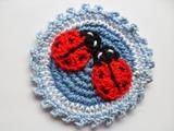 crochet badge/button Ladybugs on blue