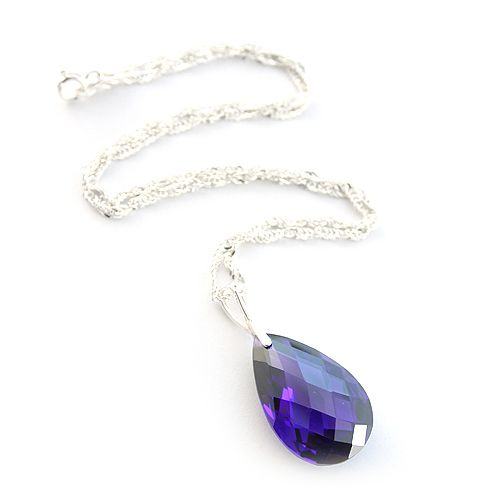 Purple cubic zirconia drop hanging on a silver chain. Retro and elegant.