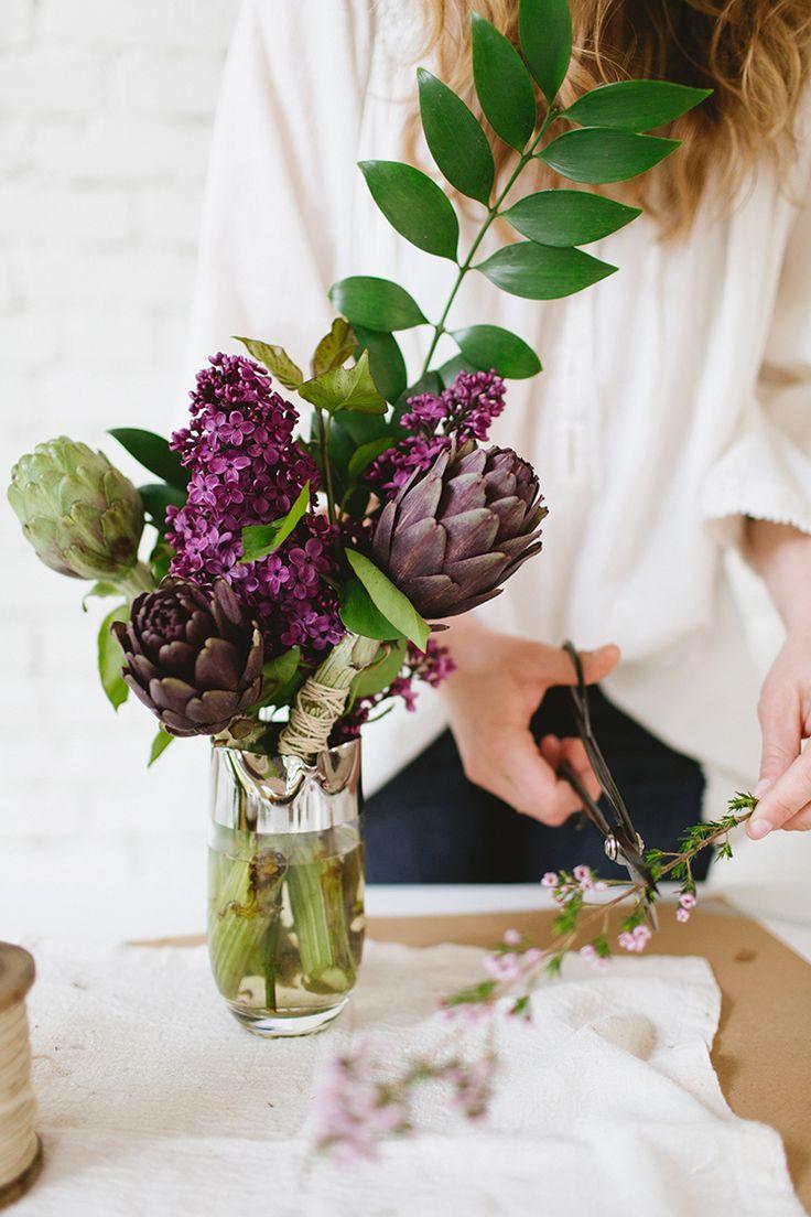 fresh flower arrangement uses artichokes and lilacs www.jojotastic.com photography by @meghanklein