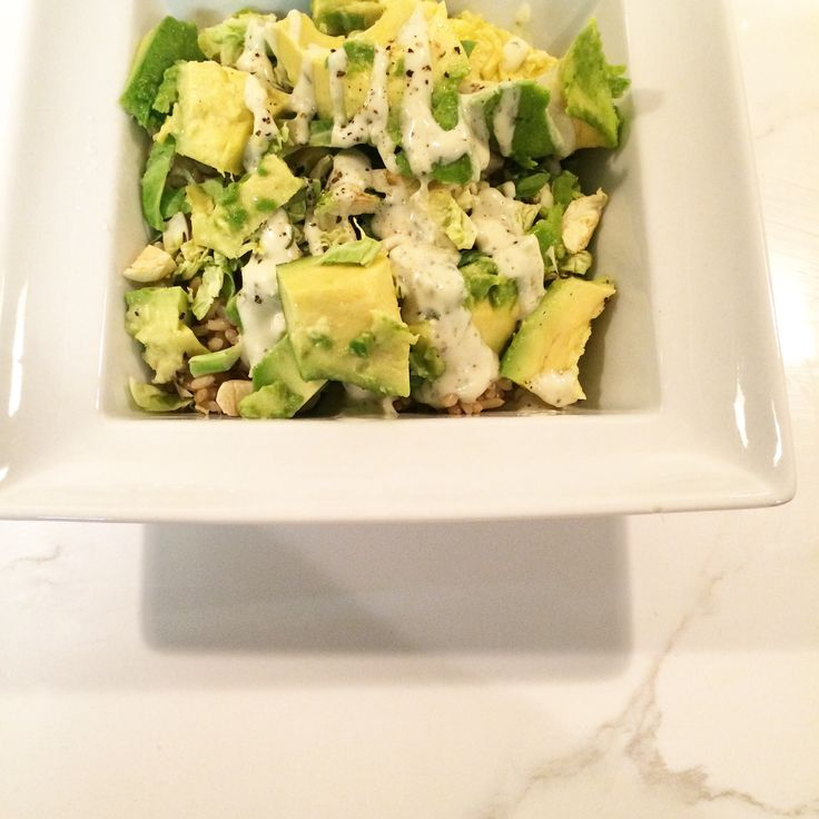 Avocado Brussels Sprout Salad for a clean eating meal topped with Bolthouse farms Avocado Cilantro dressing