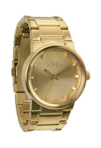 The Nixon Cannon all gold watch is a modern classic. For elegant style pair this muted all gold, delicately simple face with a chic sheepski...