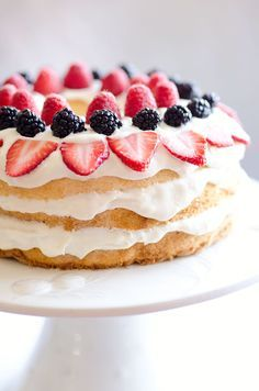 Light Berry Angel Food Cake is an easy and delicious 15 minute dessert with only 5 ingredients. Angel food cake is layered with luscious white chocolate Cool Whip and topped with fresh berries for a guilt-free treat!