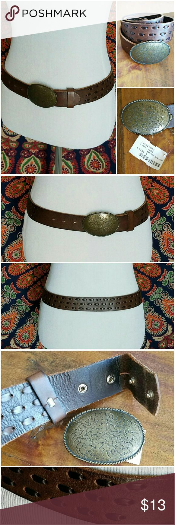 Detachable Embossed Buckle Brown Leather Belt Dark brown leather belt with darker bands of leather woven through. Snap buttons for buckle. Floral embossed oval shaped buckle included. 5 pre-punched holes on tongue adjust from approximately 30 to 34 inches. NWT. MEASUREMENTS with Buckle - 37.5 inches long x 1.5 inches wide. 35 inches long without buckle. Buckle 3in long x 2.25in wide. MATERIAL- Genuine Leather. Accessories Belts