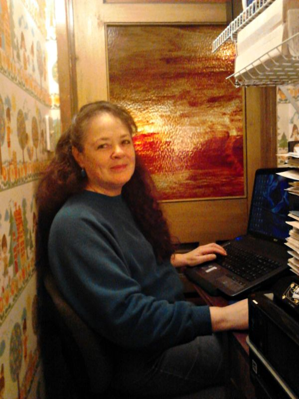 Ever since I moved my writing office into a three-by-seven foot cubbyhole under the stairs, my husband has had no end of fun with his wife being in the closet. Why did I abandon my roomy office in favor of such a cramped space? It happened a little at a time but has reaped a surprising benefit.