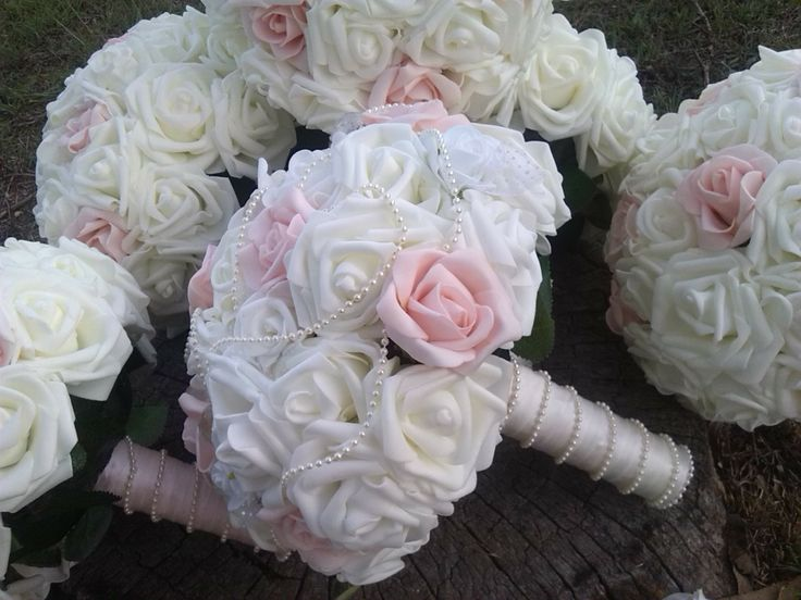Pretty white and pink bouquets with pearl stems!