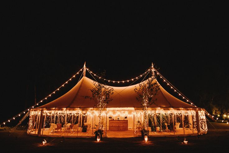 White canvas, swooping roof lines, wooden pole marquee hire in Yorkshire. Creating magical spaces for any party or wedding celebration.
