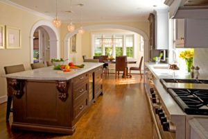 This is an idea for a traditional eat-in kitchen with arches with molding separating the kitchen with the dining area and other parts of the house. There is a kitchen island with cabinets and granite countertops, a undermount sink, recessed-panel cabinets, and stainless steel appliances. The openness of space is also notable. Photo by Anthony Wilder Design/Build, Inc. - Look for traditional kitchen design inspirationThis is an idea for a traditional eat-in kitchen with arches with molding…