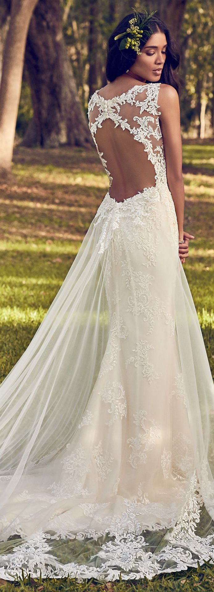 Bhavna's note: Love the sheer layer and the train on this one with lace/beading on the train. Also really like how the skirt dips in above the butt. Would love an additional sheer layer that trails like this.