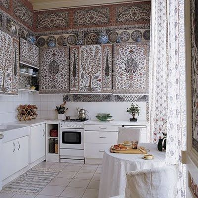 Kitchen of the Paris flat of Dimonah and Mehmet Iksel, featured in Elle Decor. Indian pattern painted on cabinets