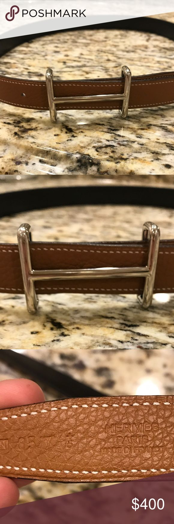 Hermes Reversible Black/Tan Belt 85 Idem Buckle 100% Authentic Hermes Leather Belt - reversible black/tan.  85 cm.  Silver palladium authentic Hermes buckle.  Perfect condition- no signs of wear.  3 belt holes but holes could be added by a professional.  Absolutely gorgeous!  Price firm. Hermes Accessories Belts