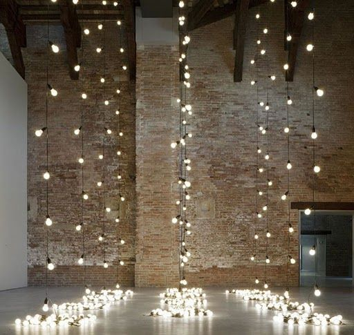 Lights hanging from the the brick ceiling