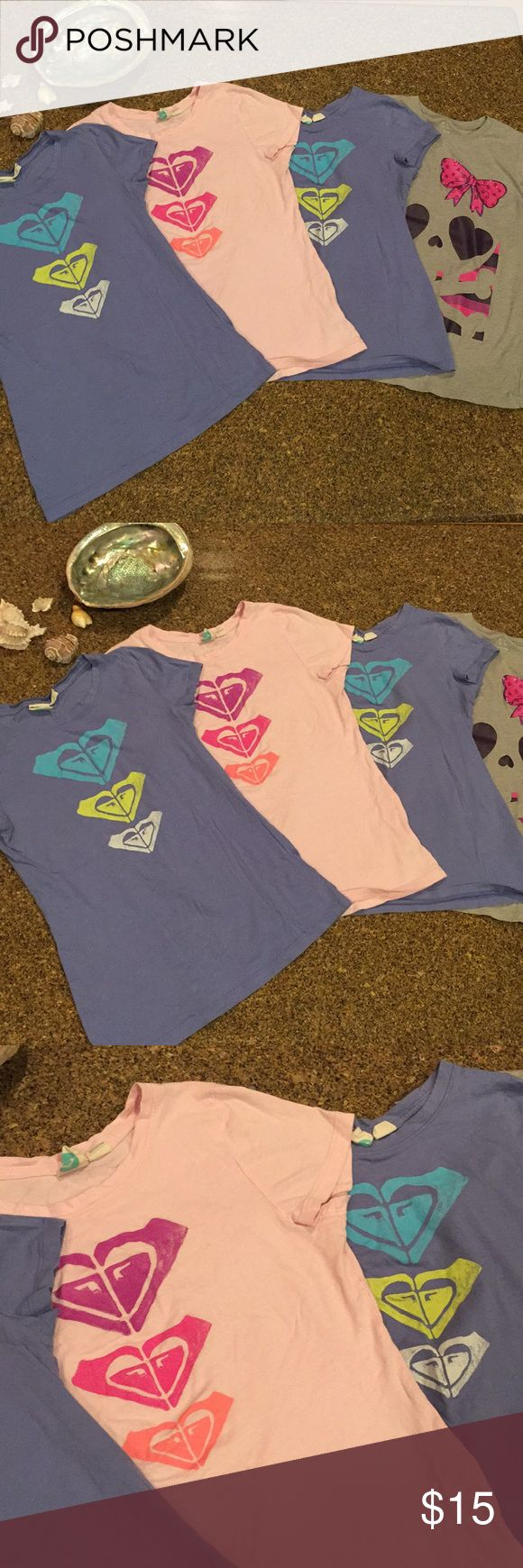 Roxy T-shirts Selling three Roxy T-shirts the gray one is thrown in for free. All only worn a few times before my girls grew out of them. They are listed size extra-large 14 girls but would fit an extra small woman. Roxy Tops Tees - Short Sleeve