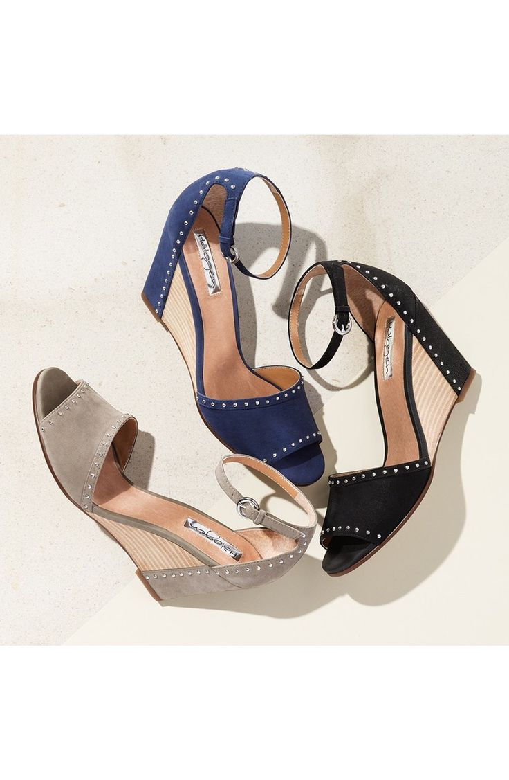 Polished studs trace the svelte silhouette of these supremely versatile stacked-wedge sandals that are perfect for the warm weather.