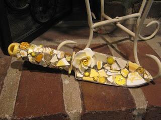 Mosaic garden trowel in yellow with ceramic flower, mosaic art.