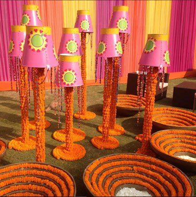 Magic with #marigold | #DIY #decorideas for the #weddinghouse #budgetfriendly | Garden decor with marigold uvulas and buckets | Curated By www.wittyvows.com | Witty Vows | Advice for Indian Brides | Indian Wedding Ideas | The ultimate guide for the Indian Bride to plan her dream wedding. Witty Vows shares things no one tells brides, covers real weddings, ideas, inspirations, design trends and the right vendors, candid photographers etc.| ♥ ♥ ♥ | #bridal #fashion #inspiration #IndianWedding
