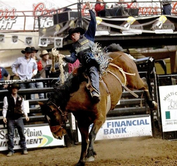 Jesse Wright holds on during the saddle bronc riding competition during the San Angelo Stock Show and Rodeo at the Foster Communications Coliseum Friday evening, Feb. 14.