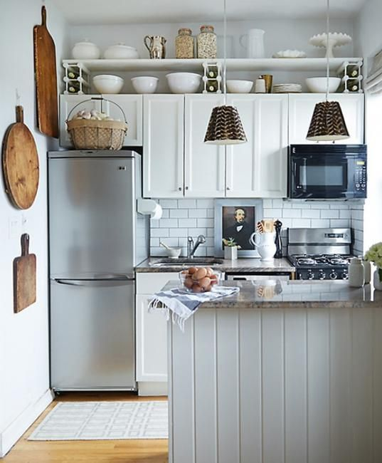 A perfect small space kitchen - light colour scheme, limited pattern, simple design.