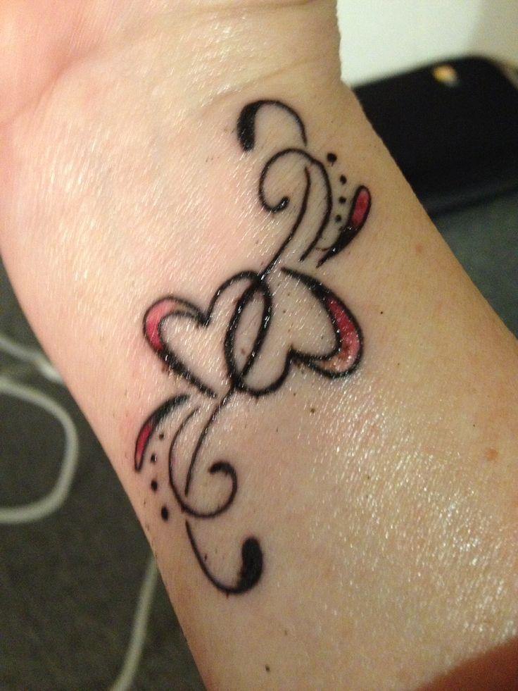 Double heart wrist tattoo