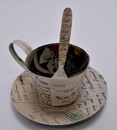 Mechanical Paper Art created by UK artist Jennifer Collier. Seen here: Teacup made from postcards / http://www.jennifercollier.co.uk