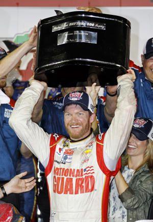 Dale Earnhardt Jr. raises the trophy in Victory Lane…