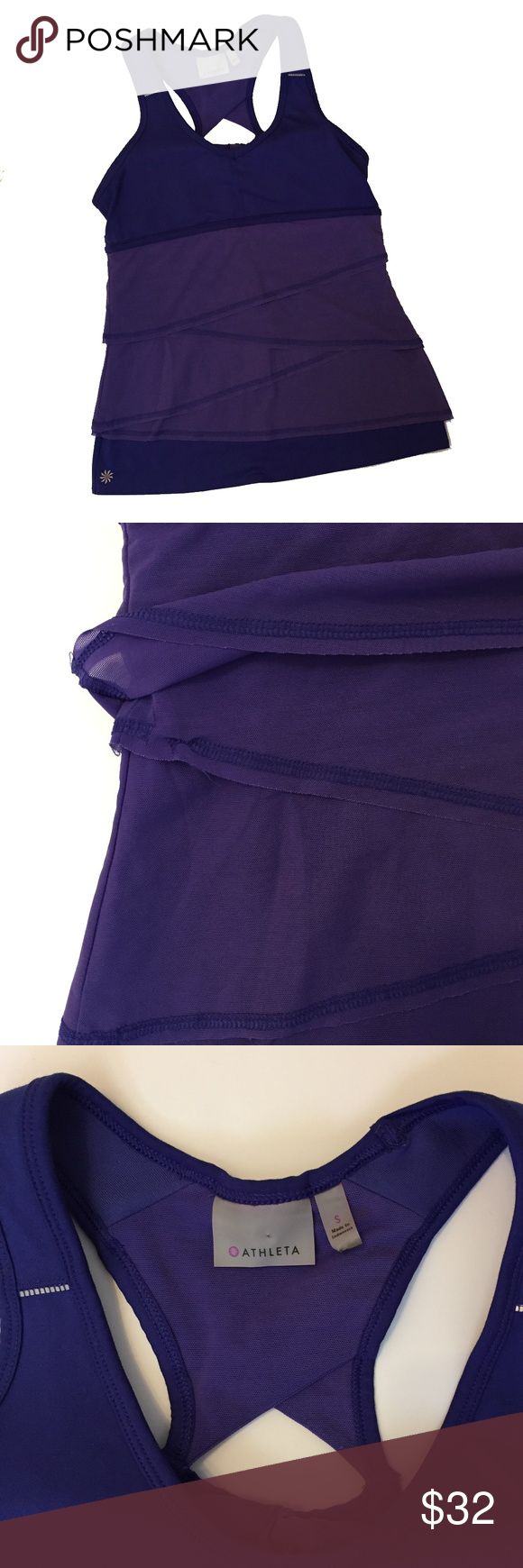"""Athleta work-out yoga tank w/ built-in bra S This Athelta yoga or work-out purple tank top is super cool!  Has asymmetrical layers of a lighter purple mesh fabric as an adorable detail.   There is an area where the threading has come undone.  It is underneath one of the layers, so it isn't noticeable.  There also appears to be one area where the stitching got caught while being sewn!  Again, not noticeable, but I wanted to point it out.  Bust- 15"""" Length- 24"""" Measurements are taken flat and…"""