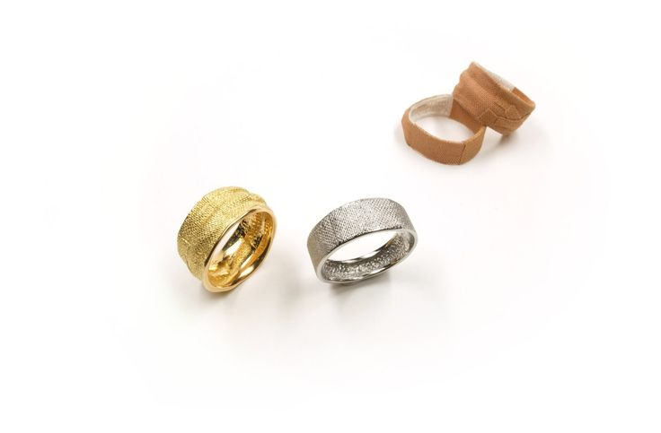 Two worn and two shortly worn <em>Pflasterringe</em> [plaster rings], 2014. Plaster respectively 750 yellow gold, stainless steel. Stainless steel 407 €, yellow gold depending on width and size ca. 1000–1600 €.