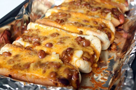Oven Hot Dogs*8 hot dogs,8 hot dog buns,1 can of chili,1/2 an onion, diced,  cheddar cheese,mayonnaise,mustard,  sweet relish.Preheat over to 350 degrees. Line inside hot dog buns with mayonnaise & sweet relish. Evenly add mustard. Fill with hot dogs & put in 13×9″ baking pan.  Top hot dogs w/ chili, cheese & diced onion. Cover w/ foil & bake for 45 minutes.
