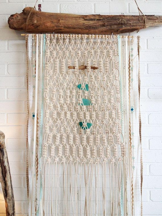 Hand made in Seal Beach. Each driftwood Macrame wall is unique and different. You will receive one very similar to this one. The Driftwood will be different but just and natural and beautiful. The Seaglass is in shades of Turquoise and Aqua. the measurement is approximately 27-30