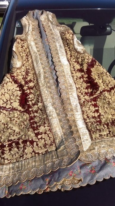 Late-20th century version of a traditional 'pirpiri' coat.  Part of a bridal costume from Epirus (northern Greece).  Embroidered with golden metal thread.