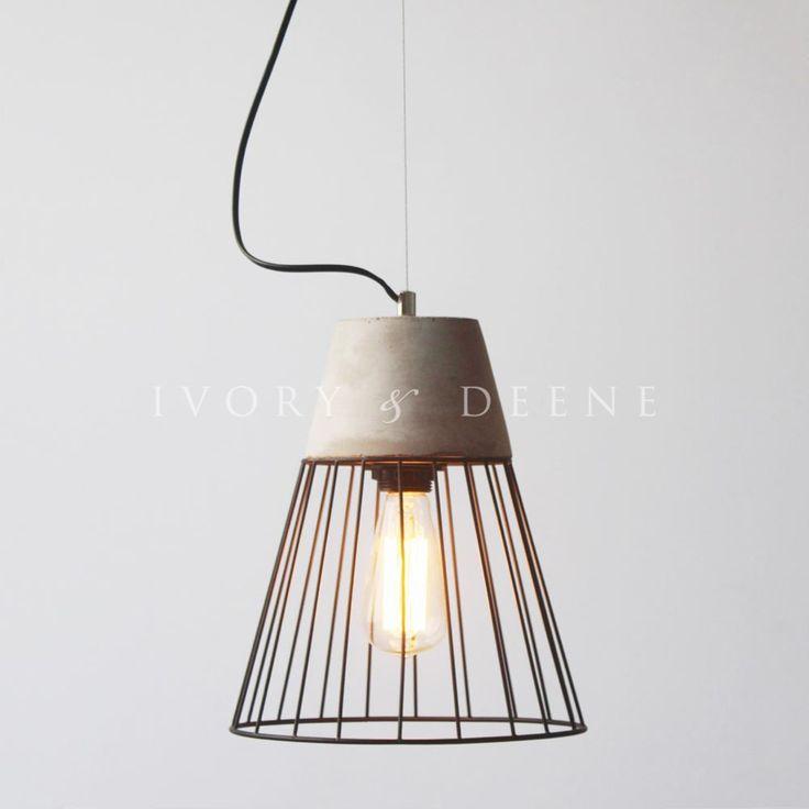 grey concrete pendant light with black wire surround