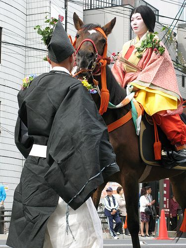 "The Aoi Matsuri (葵祭), or ""Hollyhock Festival,"" is one of the three main annual festivals held in Kyoto, Japan. It is a festival of the two Kamo shrines in the north of the city, Shimogamo Shrine and Kamigamo Shrine."