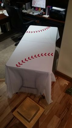 Baseball party - Dollar store plastic tableclothes with vinyl stitching to make the theme come to life!