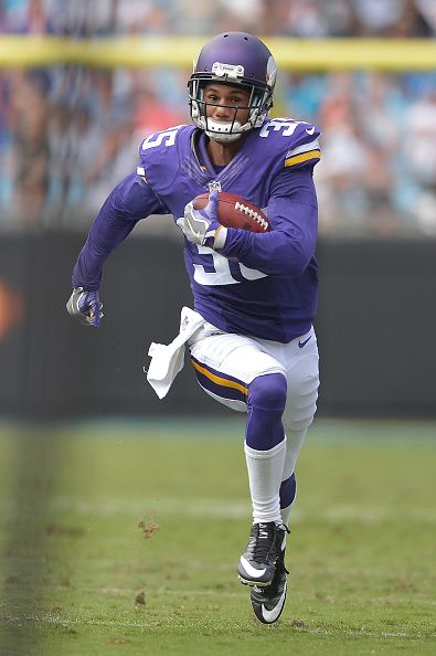 Marcus Sherels of the Minnesota Vikings returns a punt for a touchdown against the Carolina Panthers during the game at Bank of America Stadium on...