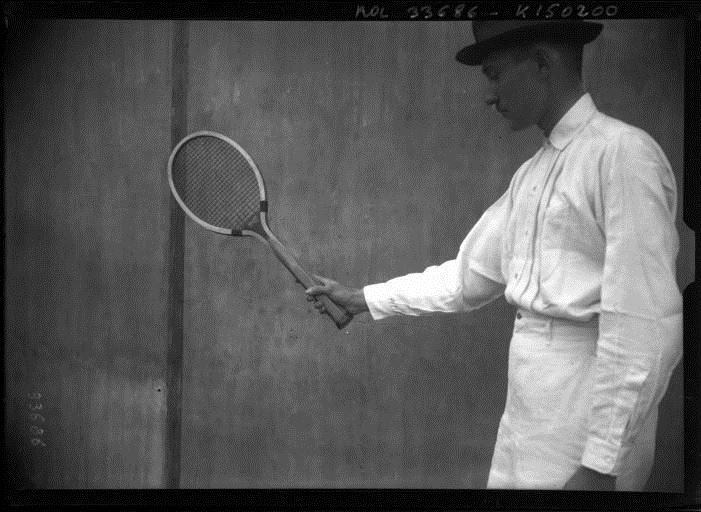 Gobert showing a tennis racket by Agence Rol, 1913. National Library of France, Public Domain