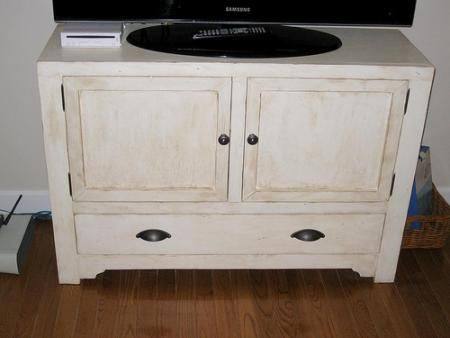 Rustic Media Console. DIY Furniture Plan from Ana-White.com  This simple closed media console can be built with or without drawers. Add a rustic finish and hardware, and create a beautiful spot for your tv - or use as a console table.
